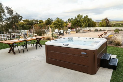 Outdoor hot tub installation on a concrete patio