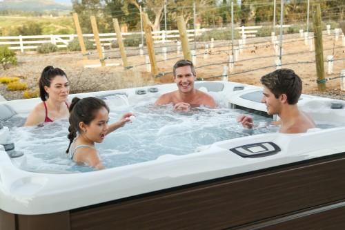 Family having fun in their Sundance Spas hot tub.