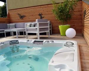Outdoor hot tub deck installation.