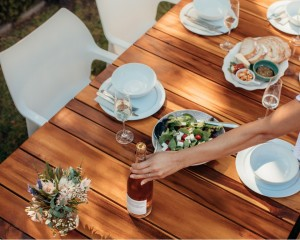 woman-setting-a-dining-table-for-housewarming-picture